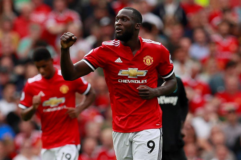 Manchester United's Romelu Lukaku celebrates scoring their first goal in the Premier League match between Manchestern United and West Ham United, in Manchester, Britain, on August 13, 2017. Photo: Action Images via Reuters