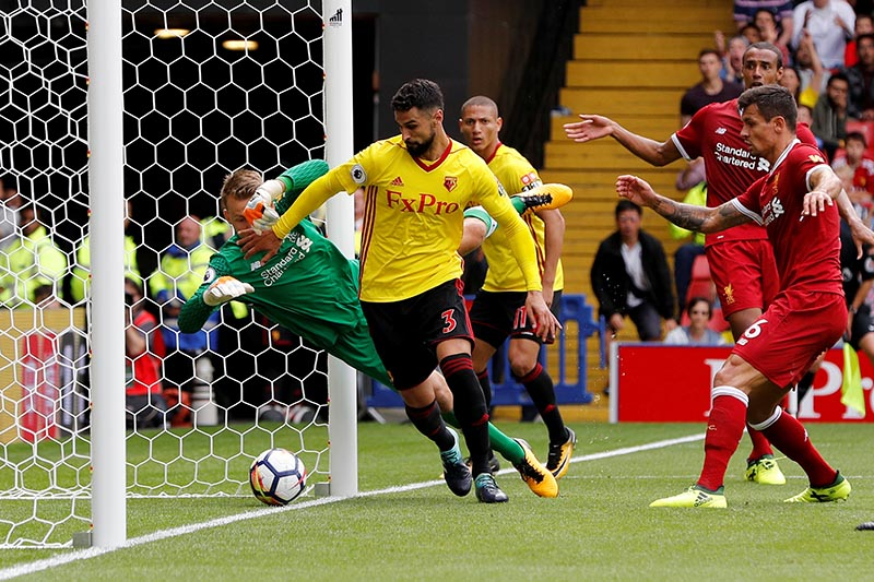 Watford's Miguel Britos scores their third goal in Premier League match between Watford and Liverpool, in Watford, Britain, on August 12, 2017. Photo: Reuters