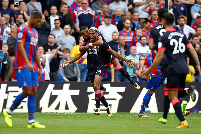 Huddersfield Townu2019s Steve Mounie celebrates scoring their second goal in the Premier League match betwen Crystal Palace and Huddersfield Town, in London, Britain, on August 12, 2017. Photo: Action Images via Reuters