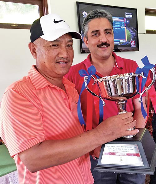 Defense Attache at the Embassy of India, Col Man Raj Singh Mann (right) handing over the winneru2019s trophy to Ang Tshiring Sherpa after the Farewell Golf Tournament in Kathmandu on Saturday. Photo: THT