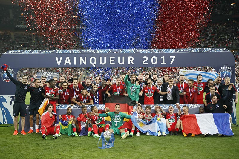 FILE - The Paris Saint-Germain's team celebrate with their trophy after winning the French Cup 2017 Final soccer match, between Paris Saint-Germain (PSG) and Angers at Stade de France in Saint Denis, north of Paris, France, on May 27, 2017. Photo: AP