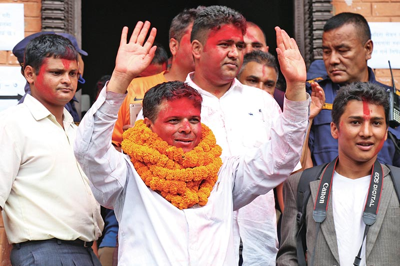 Govinda Acharya waving to supporters after being elected president of Federation of Nepali Journalists, in Kathmandu, on Tuesday, August 22, 2017. Photo: RSS
