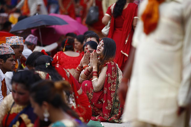 Women devotees offer ritual prayers during Teej festival on the premises of Pashupathinath Temple in Kathmandu, on Thursday, August 24, 2017.  Photo: Skanda Gautam