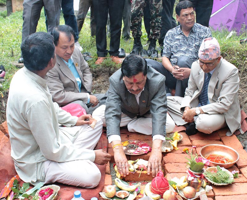 Minister for Youth and Sports Rajendra Kumar KC (centre) performs rituals during the foundation stone laying ceremony of heated swimming pool at the International Sports Complex in Lalitpur on Friday, August 11, 2017. Photo: THT