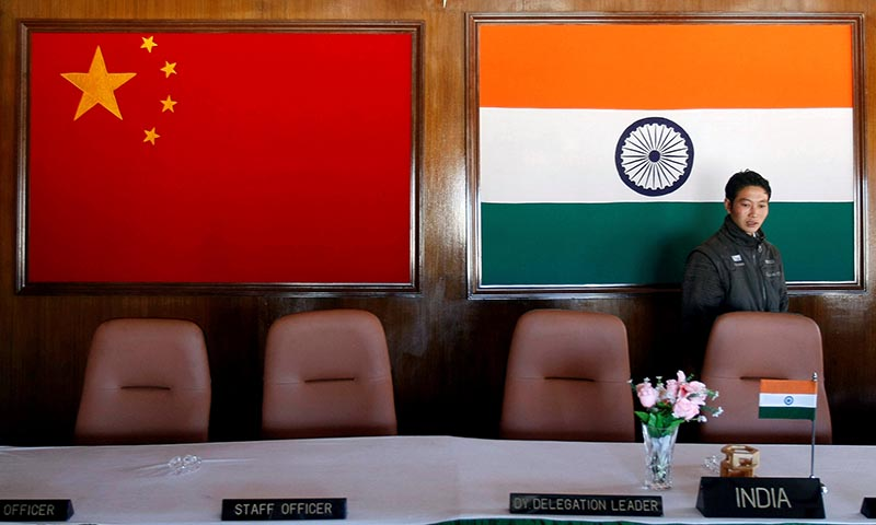 A man walks inside a conference room used for meetings between military commanders of China and India, at the Indian side of the Indo-China border at Bumla, in the northeastern Indian state of Arunachal Pradesh, on November 11, 2009. Photo: Reuters