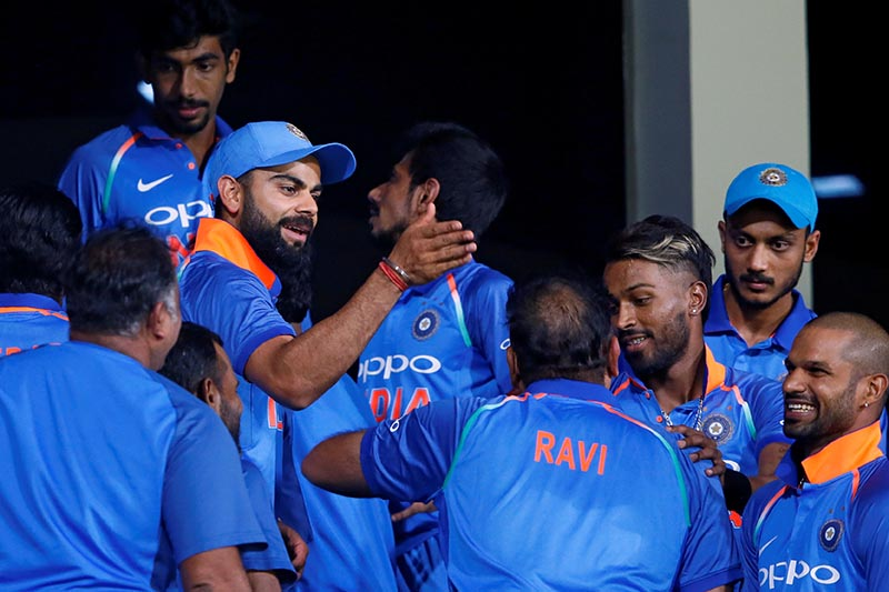 India's captain Virat Kohli celebrates with his teammates at the dressing room after they won the second one-day international match between Sri Lanka and India, in Pallekele, Sri Lanka, on August 24, 2017. Photo: Reuters