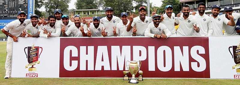 India's cricket team hold the trophy for photographs after they won the match and test cricket series against Sri Lanka in third test match, on Pallekele, Sri Lanka, on August 14, 2017. Photo: Reuters