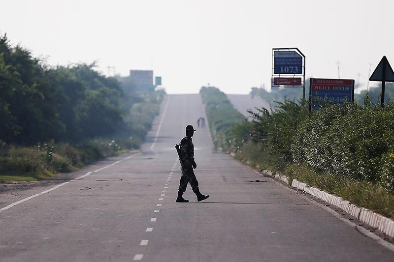 A paramilitary soldier patrols on a closed road leading to Sunariya Jail in Rohtak in the northern state of Haryana, India, on August 27, 2017. Photo: Reuters