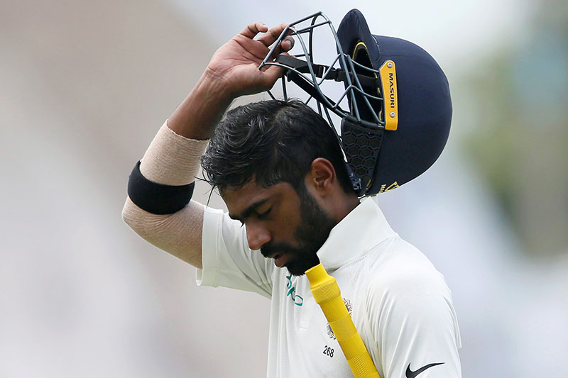India's cricketer Abhinav Mukund reacts as he walks off the field after his dismissal. Photo: Reuters