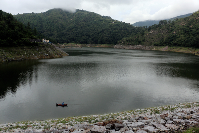 A local man is seen fishing in Indra Sarovar, the largest manmade lake in Nepal, in Kulekhani Village, on August 6, 2017. Photo: RSS