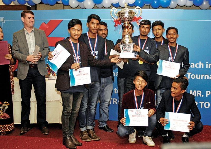 Saipal Academy players celebrate with the winnersu2019 trophy of the Inter-school A-Level Futsal Tournament u2018Huddle 2017u2019 in Kathmandu, on Sunday. Photo: THT