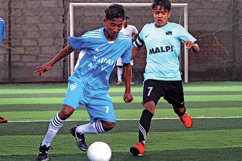 Players of Saipal Academy (left) and Malpi Institute vie for the ball during their Inter-school A-Level Futsal Tournament match in Kathmandu on Saturday. Photo: THT