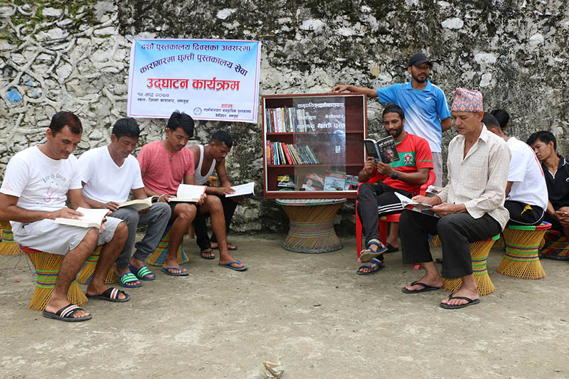 Jailbirds studying books after ingurating mobile library in Lamjung district, on Wednesday, August 30, 2017. Photo: RSS