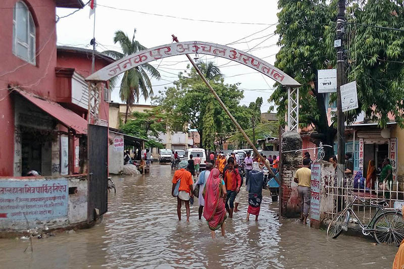 People struggling to walk through inundated roads of Janakpur Zonal Hospital in Janakpurdham, on Friday, August 11, 2017. Photo: RSS
