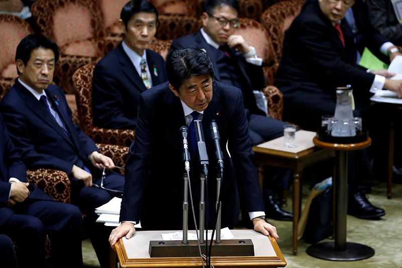 Japan's Prime Minister Shinzo Abe (centre) speaks at the upper house parliamentary session after reports on North Korea's missile launches, in Tokyo, Japan, on March 6, 2017. Photo: Reuters/ File
