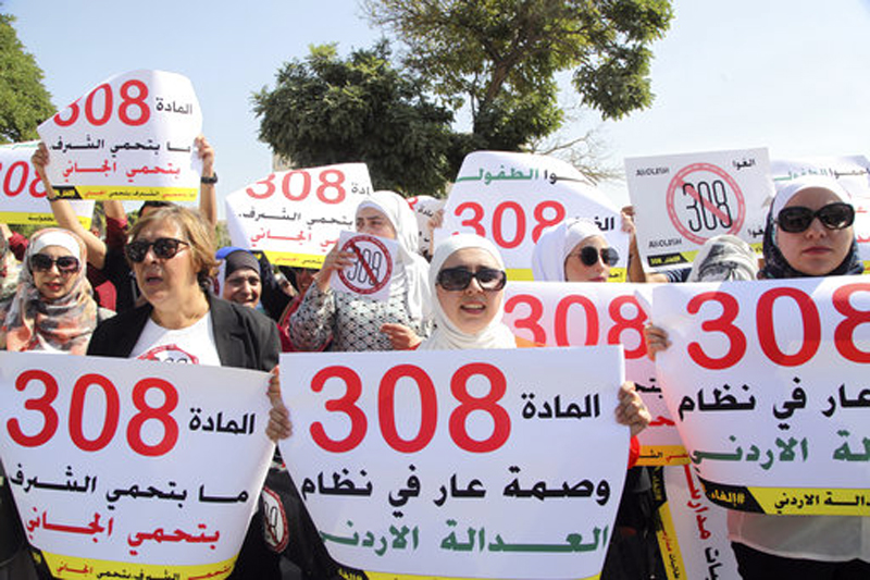 Women activists protest in front Jordan's parliament in Amman on Tuesday, August 1, 2017 with banners calling on legislators to repeal a provision that allows a rapist to escape punishment if he marries his victim.u00a0Photo: AP