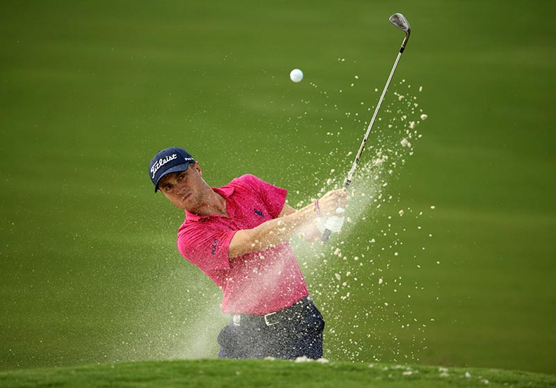 Aug 13, 2017; Charlotte, NC, USA; Justin Thomas plays from a bunker on the 16th hole during the final round of the PGA Championship at Quail Hollow Club. Mandatory Credit: Rob Schumacher-USA TODAY Sports