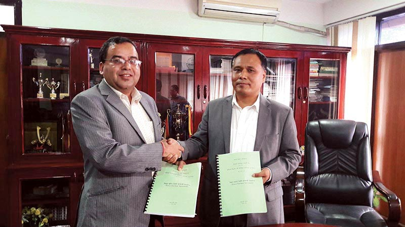 NEA Managing Director Kulman Ghising and MD of Trishuli Jal Vidhyut Company Mohan Prasad Gautam shaking hands after signing PPA of Upper Trishuli 3B project, in Kathmandu, on Wednesday, August 23, 2017. Photo: THT