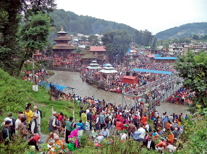 FILE - Devotees throng Gokarneshwor Temple on the occasion of Kuse Aunshi in Kathmandu, on Monday, August 21, 2017. Photo: RSS