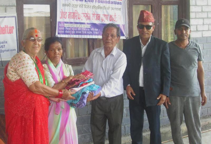 Clothes being distributed to elderly citizens on the occasion of  Kushe Aunsi in an old age home in Pokhara, on Monday, August 21, 2017. Photo: THT