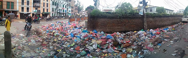 A motorcyclist passing through a litter-strewn road, in Lalitpur, on Wednesday, August 30, 2017. Photo: THT