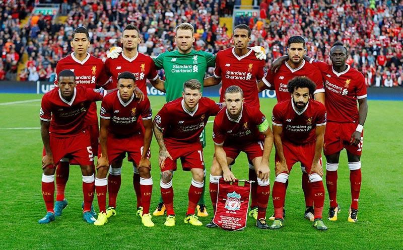 Liverpool pose for a team group photo before the match. Photo: Reuters