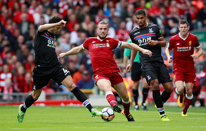 Liverpool's Jordan Henderson in action with Crystal Palace's Luka Milivojevic and Ruben Loftus-Cheek in action. Photo: Reuters