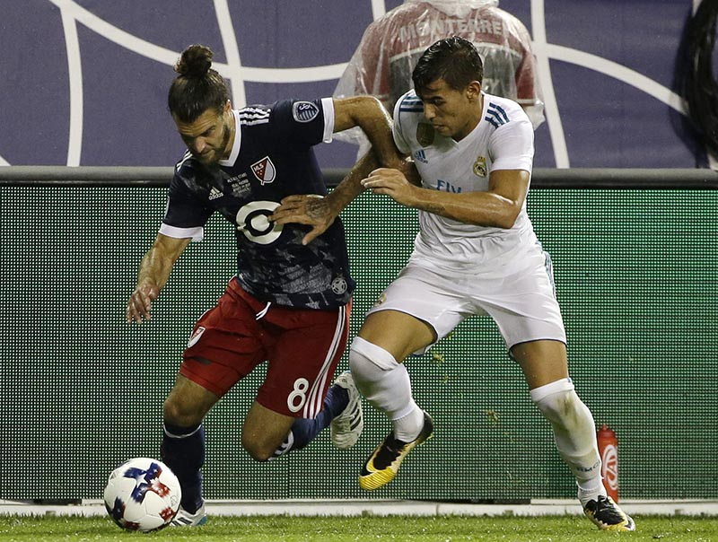 MLS All-Stars' Graham Zusi (left) controls the ball against Real Madrid's Theo Hernandez during the first half of the MLS All-Star Game, Wednesday, Aug. 2, 2017, in Chicago. Photo: Nam Y. Huh via AP