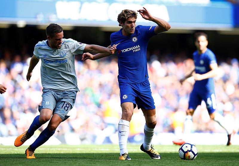 Chelsea's Marcos Alonso in action with Everton's Gylfi Sigurdsson. Photo: Reuters