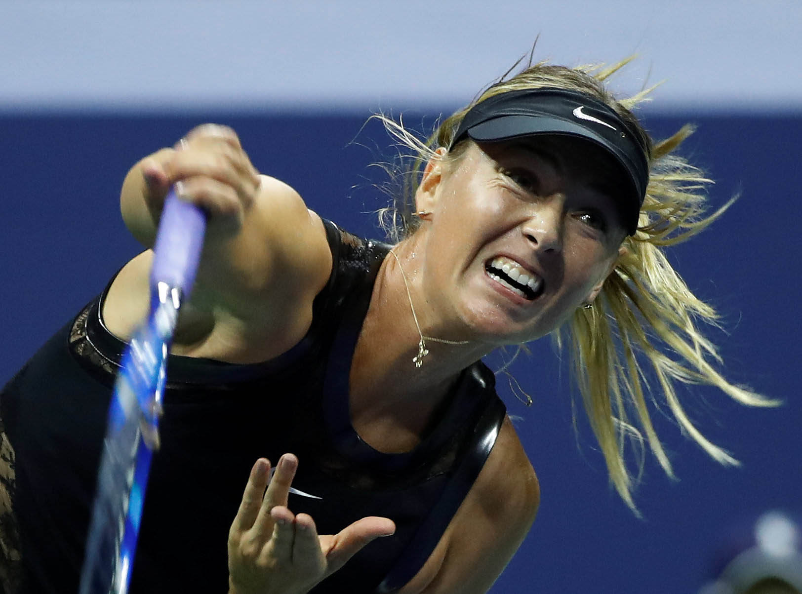 Maria Sharapova of Russia in action against Simona Halep of Romania during their first round match in the US Open, in New York, US, on August 28, 2017. Photo: Reuters