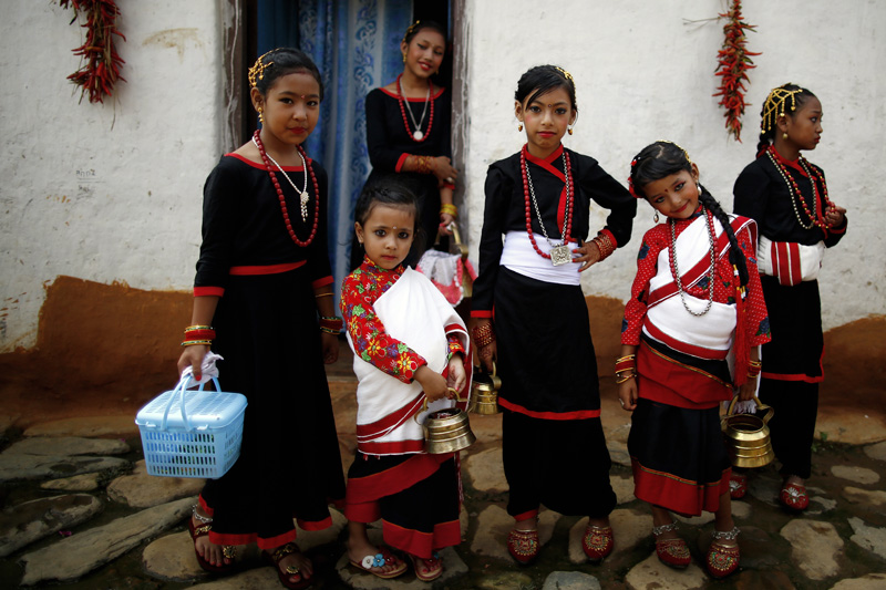 Girls from Newar community pose for a picture before a parade during Mataya festival, the festival of lights to pray for the departed in Lalitpur, on Wednesday, August 09, 2017. Photo: Skanda Gautam