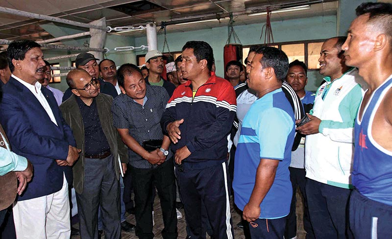 Minister for Youth and Sports Rajendra Kumar KC (left) listens to boxing officials about their national team preparation at the Dasharath Stadium in Kathmandu, on Tuesday. Photo: Udipt Singh Chhetry/ THT