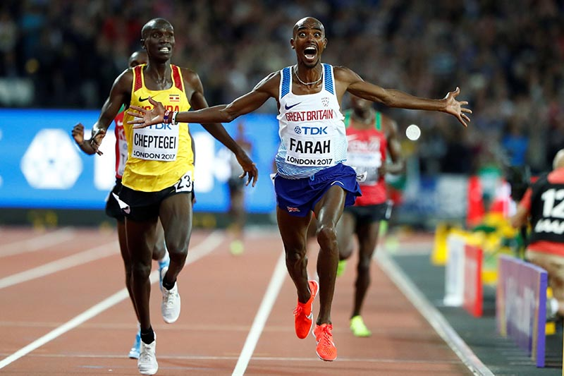 Mo Farah of Britain celebrates after winning  menu2019s 10,000 metres in World Athletics Championships, at London Stadium, in London, Britain, on August 4, 2017. Photo: Reuters