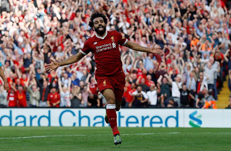 Liverpool's Mohamed Salah celebrates scoring their third goal. Photo: Reuters