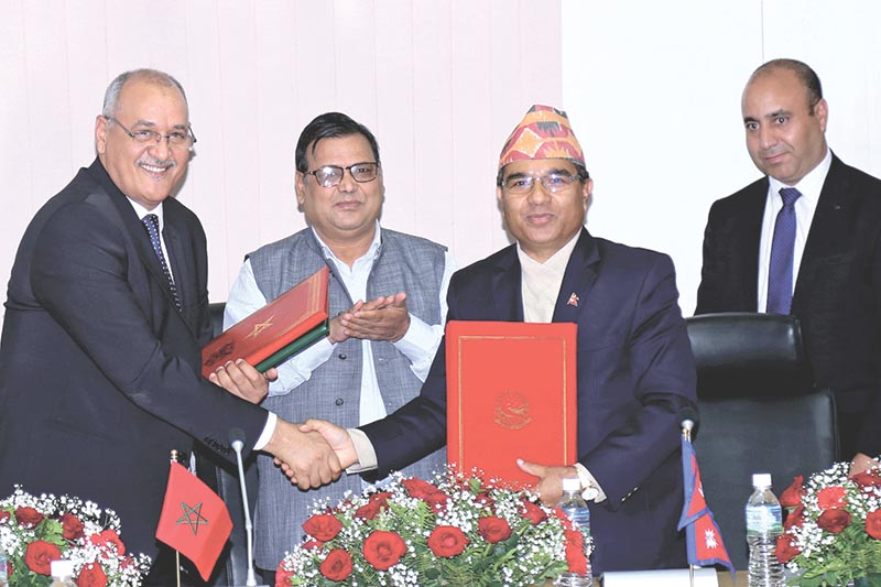 Moroccan Ambassador to Nepal Mohamed Maliki (left) shaking hands with Foreign Secretary Shankar Das Bairagi as Deputy Prime Minister and Minister for Foreign Affairs  Krishna Bahadur Mahara looks on after the signing of the MoU on formation of a bilateral consultation mechanism, in Kathmandu, on Thursday, August 3, 2017. Photo: THT