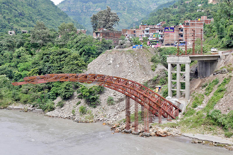 A first of its kind and presumbly assumed to be a sample bridge being constructed over Trishuli river in Muglin, of Dhading district, on Friday, August 25, 2017. Photo: RSS