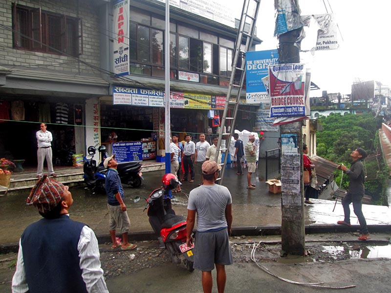 NEA personnel are seen in the process of changing damaged wire in Rani Pauwa of Pokhara Lekhnath Metropolitan City-11, on Friday, August 11, 2017. Photo Rishi Ram Baral