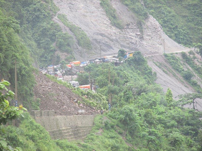 Vehicles stranded amid the rain-triggered landslides along the Narayagadh-Muglin road section, in Chitwan district, on Thursday, August 3, 2017. Photo: Shiv Khanal