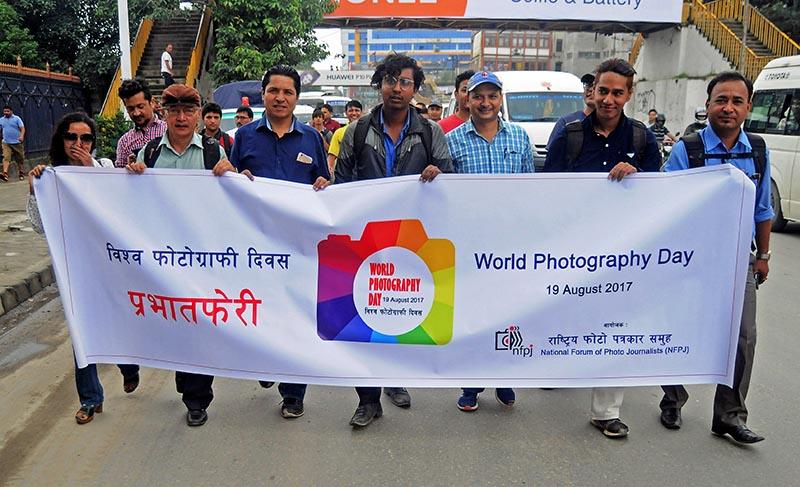 Photojournalists participating a rally to mark 178th World Photography Day organized by National Forum of Photo Journalists (NFPJ) at Bhirkutimandap in Kathmandu, on Saturday. Photo: Balkrishna Thapa Chhetri