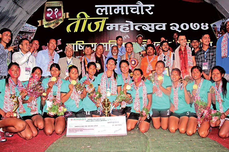 Nepal APF Club players and officials celebrate with the trophy after winning the Red Bull National Womenu2019s Volleyball Tournament in Pokhara, on Thursday. Photo: THT