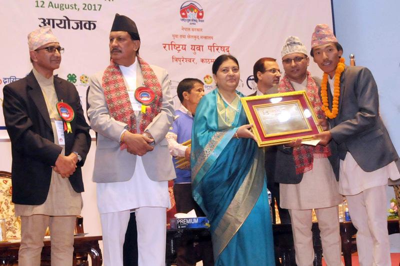 President Bidya Devi Bhandari honours Phurba Tenzing Sherpa with the National Youth Award, in Kathmandu, on Saturday, August 12, 2017. Courtesy: THT Online