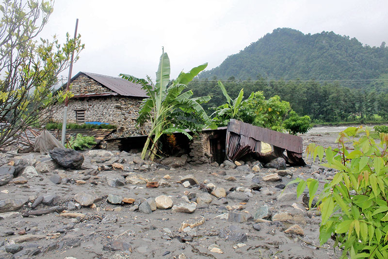 A house damaged by flood after heavy showers in rural village in Kaski district, on Wednesday, August 9, 2017. Photo: Rishi Ram Baral