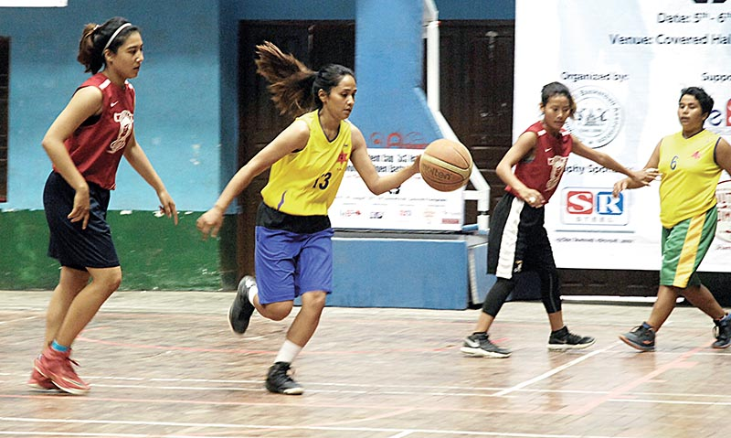 Players of Tribhuwan Army club (yellow jersey) and Prime College in action during their NeBA President 3X3 nNational-level Open Basketball Tournament match in Kathmandu, on Sunday. Naresh Shrestha / THT