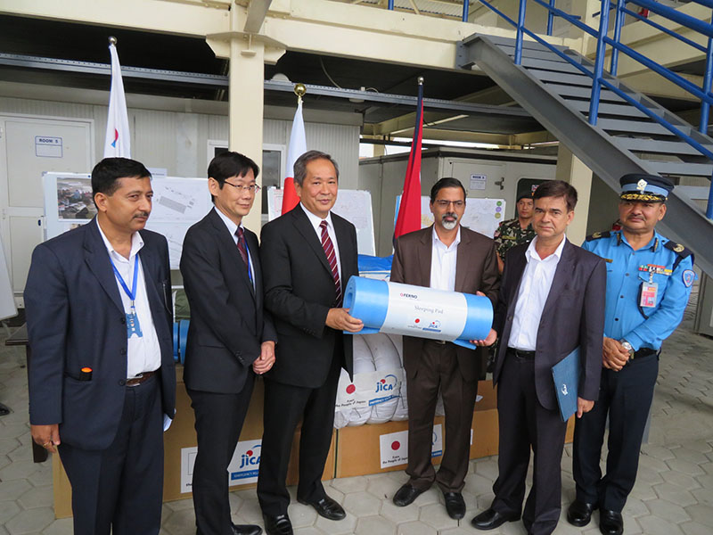 Japanese ambassador to Nepal Masashi Ogawa hands over emergency relief goods to the Home Minister Janardan Sharma amid a ceremony held at the Humanitarian Staging Area at the Tribhuvan International Airport on Wednesday, August 23, 2017. Courtesy: Japanese Embassy