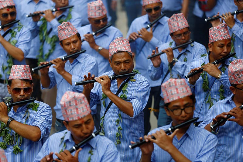 Devotees play flute during a parade commemorating the Neku Jatra-Mataya festival, the Festival of Lights, a Buddhist festival which marks the victory of Sakyamuni Buddha over Mara, in Lalitpur, Nepal, on  August 9, 2017. Photo: Reuters