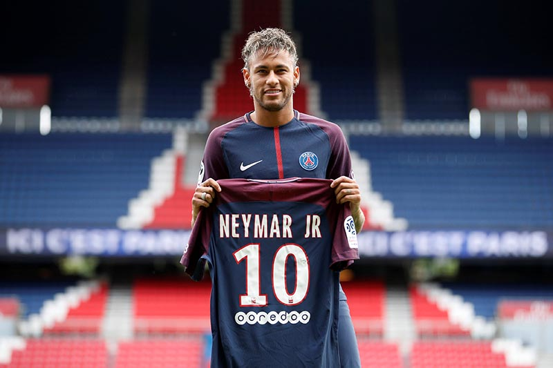 New Paris Saint-Germain signing Neymar Jr poses with the club shirt duritn a press conference at Paris Saint-Germain FC, in Paris, France, on August 4, 2017. Photo: Reuters