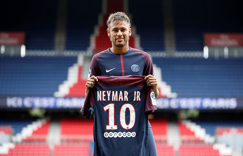New Paris Saint-Germain signing Neymar Jr poses with the club shirt. Photo: Reuters