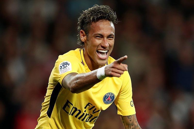 Paris Saint-Germainu2019s Neymar celebrates scoring their third goal in France Ligue 1 match between Guingamp and Paris St Germain, in Guingamp, France, on August 13, 2017. Photo : Reuters