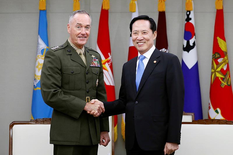 US Chairman of the Joint Chiefs of Staff General Joseph Dunford shakes hands with South Korean Defence Minister Song Young-moo during their meeting at the Defence Ministry in Seoul, South Korea, on August 14, 2017. Photo: Reuters