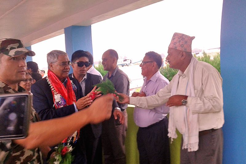 PM Deuba being greeted by locals before his departure to Kathmandu at Ranja Airport in Banke district, on Thursday, August 17, 2017. Photo: Damodar Bhandari